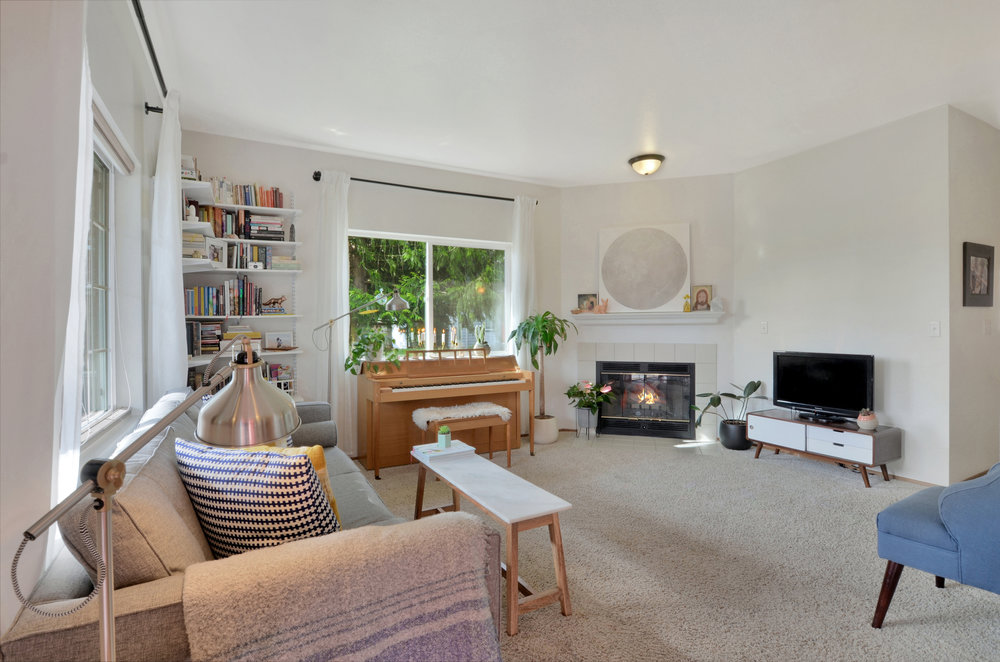 From the entry, take a left into the bright living room with its high ceilings and propane fireplace.