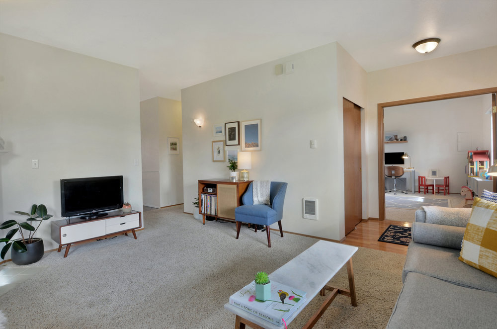 Don't miss the convenience of the coat closet and hardwood floor in the entry area.
