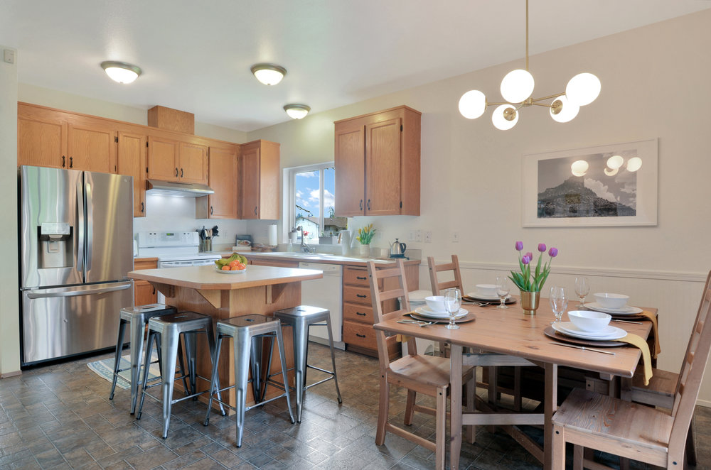 Set up for dinner in the dining area, or gather around the kitchen island for casual family dinners. With a full set of appliances (refrigerator/freezer, stove, dishwasher, and vent), this kitchen is ready for you.