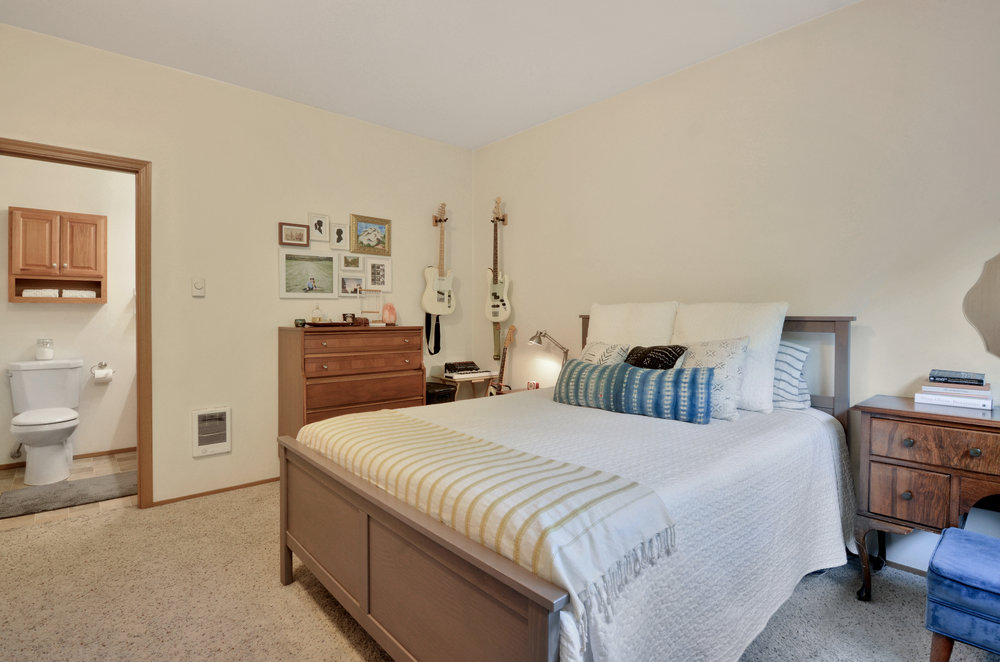 One of 3 bedrooms in the home, this room features a private en suite full bath with a jetted tub.