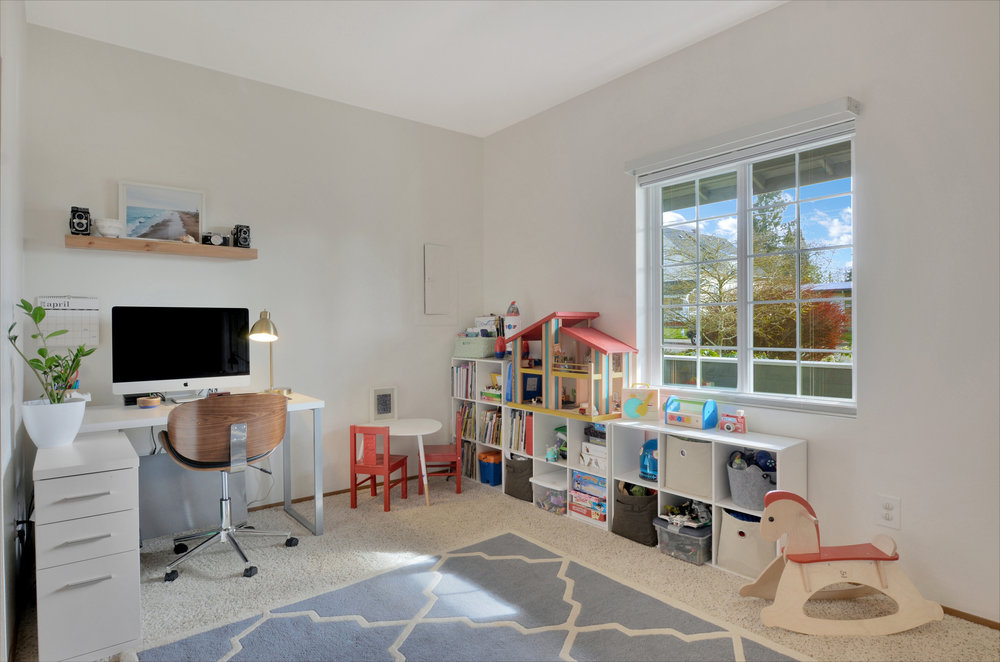 This big 3rd bedroom overlooks the front porch and offers lots of flexibility. Set it up as a bedroom, or take advantage of the opportunity to create a home office and playroom as shown here.