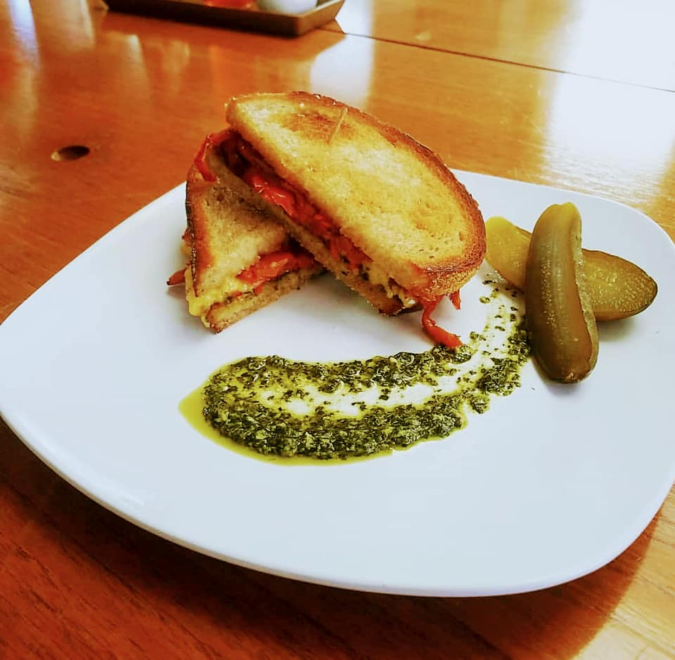 The Karen: Roasted red peppers, pesto, and aioli with vegan cheeze