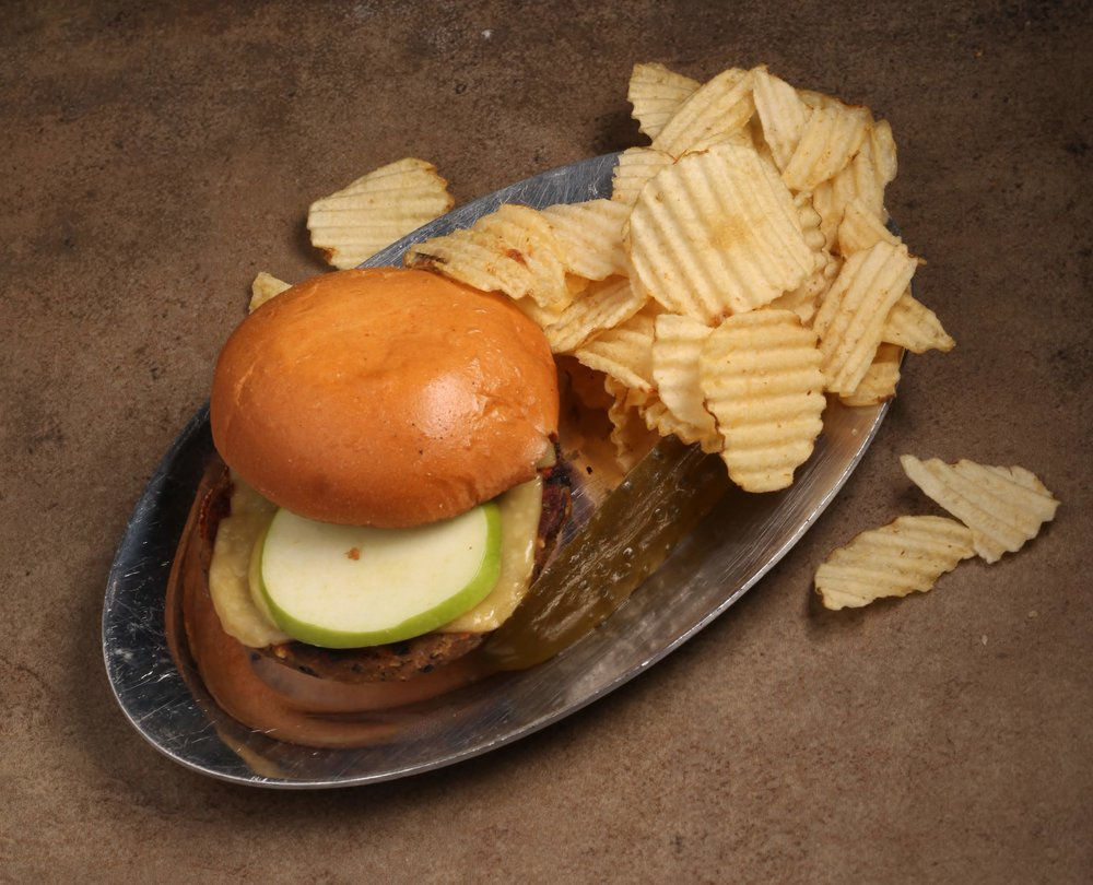 The Kaz:  House-made veggie patty topped with aioli and granny smith apple, served on a bun with vegan cheeze