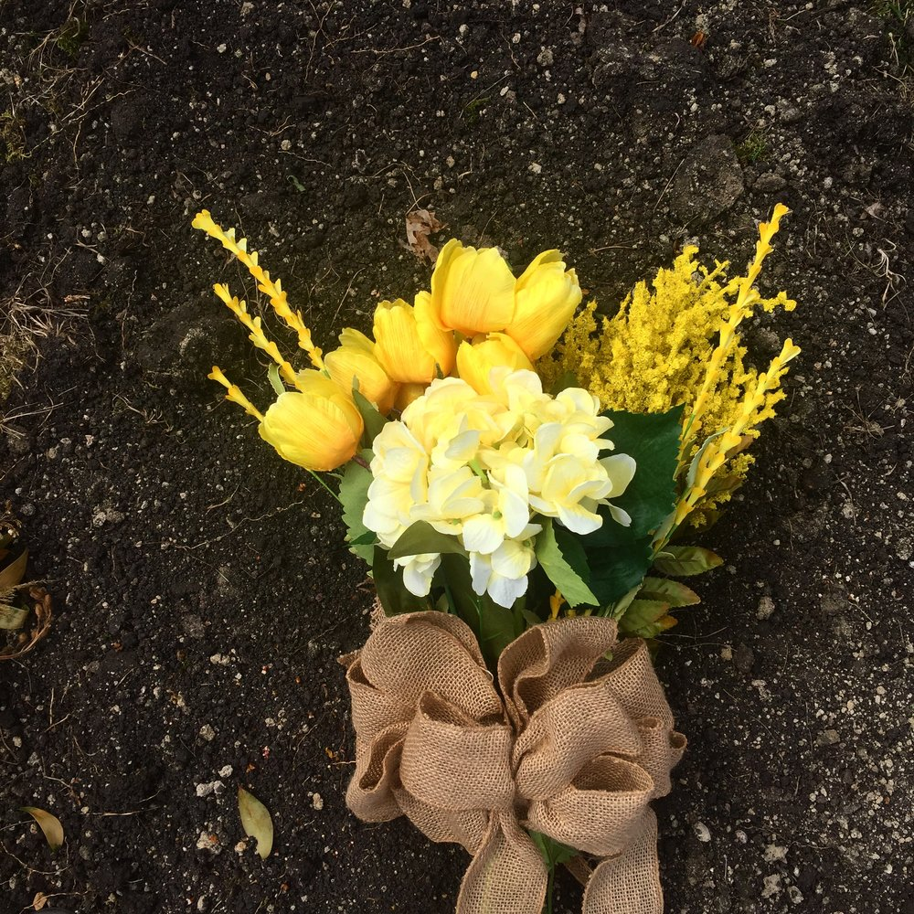 Flowers for her one month birthday! Yellow, of course, for Trisomy awareness.
