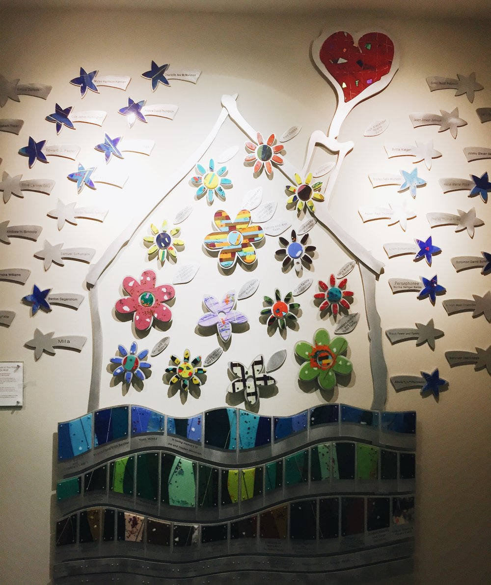 Art representing donors at the entrance to the RMH.