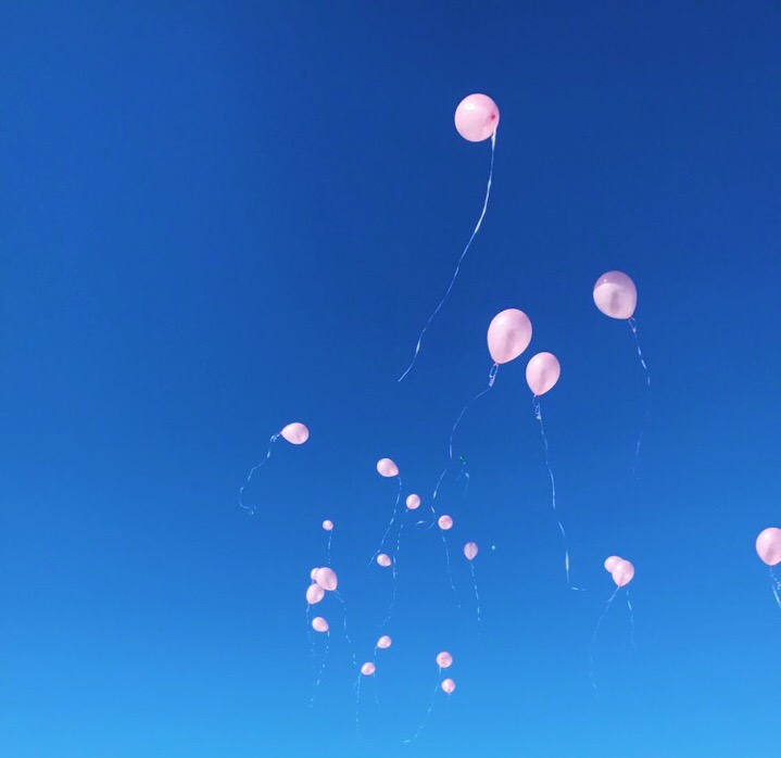 The balloon release at Norah's burial.