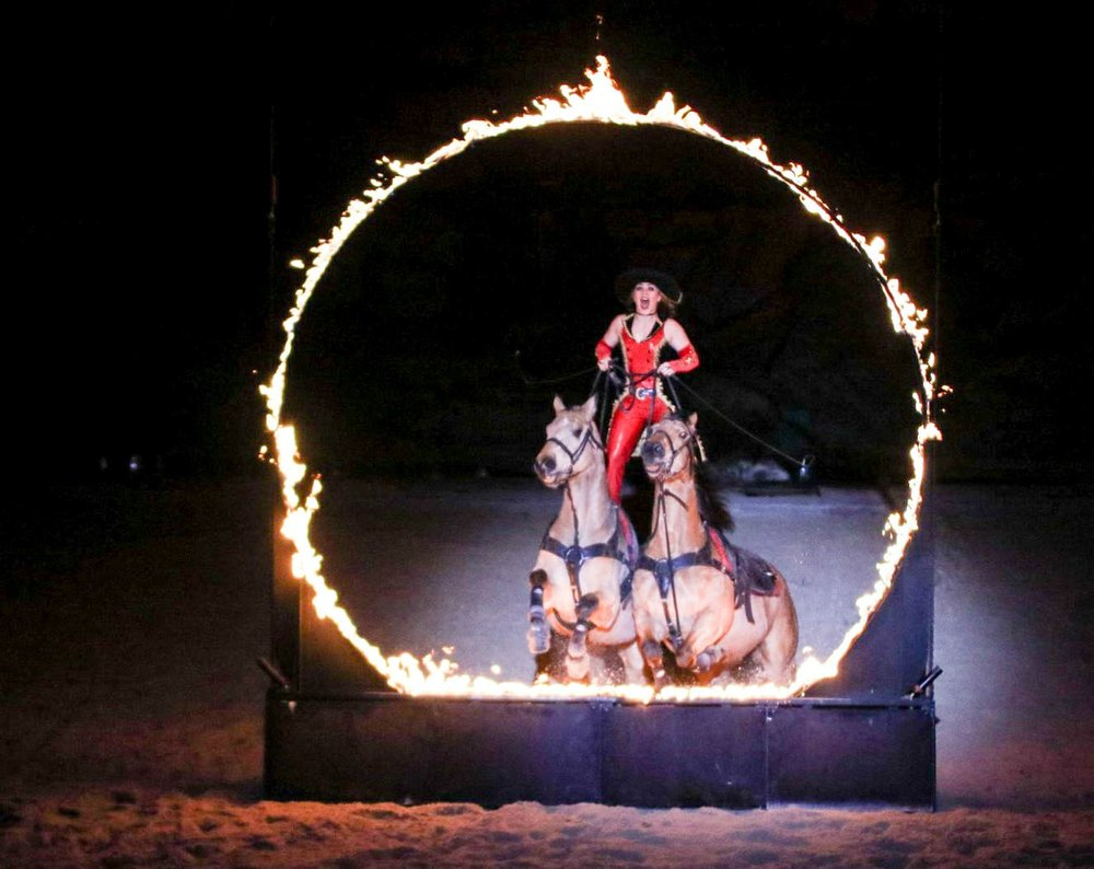 Roman Riding - Gator jumping through the hoop of fire, live during Dolly's Stampede