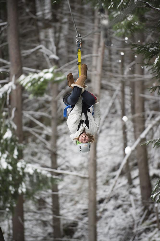 Ziptrek Queenstown girl zipping upside down through snow.jpg