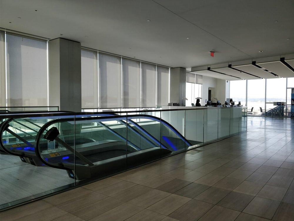 escalators in the united club