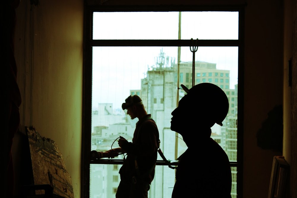 construction workers evaluating job