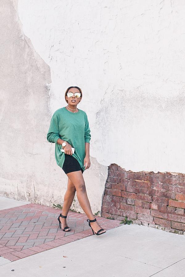 mirrored sunglasses and biker shorts
