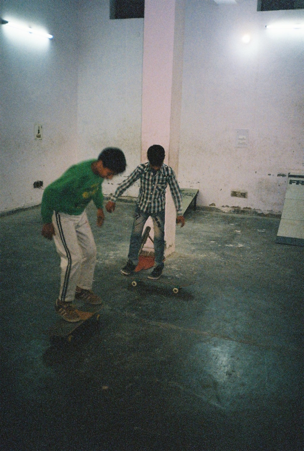 KIDS SKATING IN A MAKE SHIFT PARK IN A WAREHOUSE BASEMENT IN THE OUTER SUBURBS OF NEW DELHI.jpg