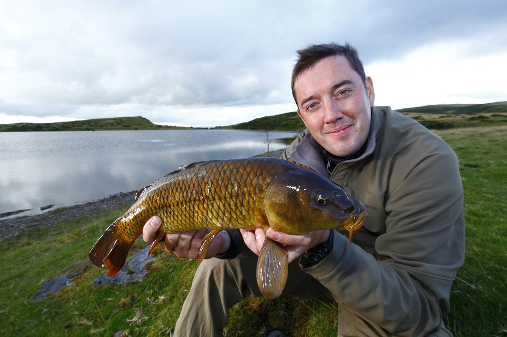 Adam Fisher with a typical mountain carp.