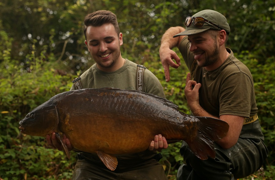 Liam hoists up Baby Orange at 35lb while a delighted Scott signals 'pb'