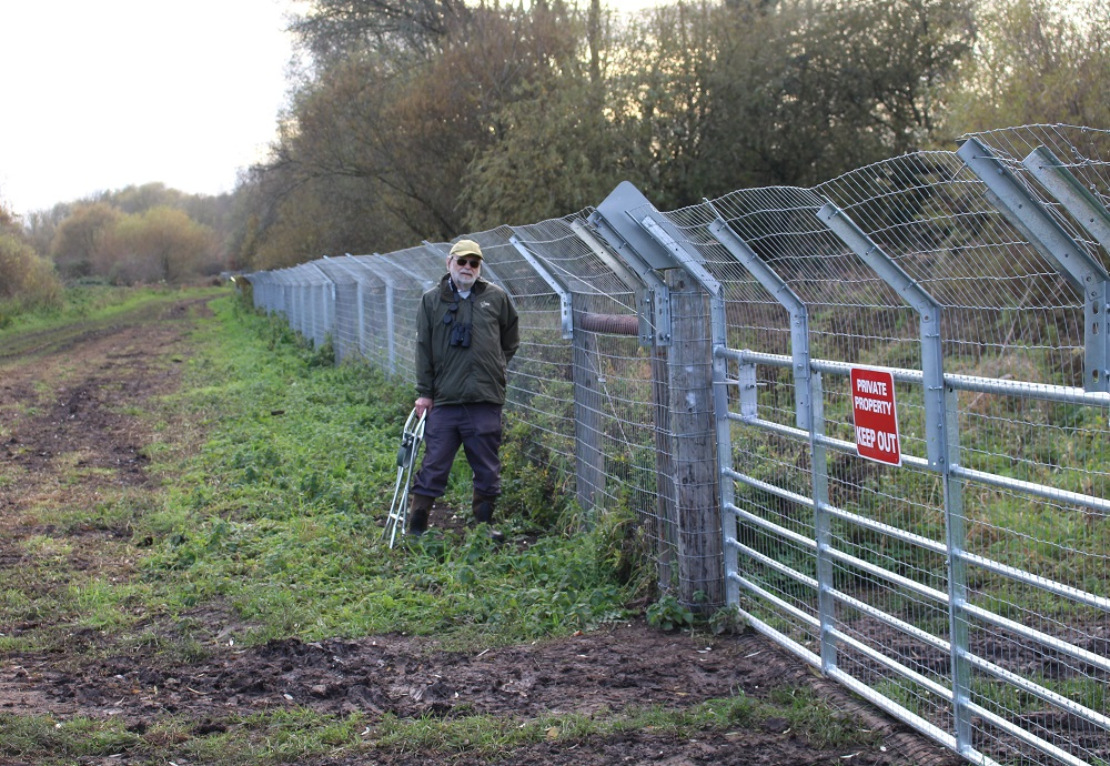 Steve Burke and his otter fence