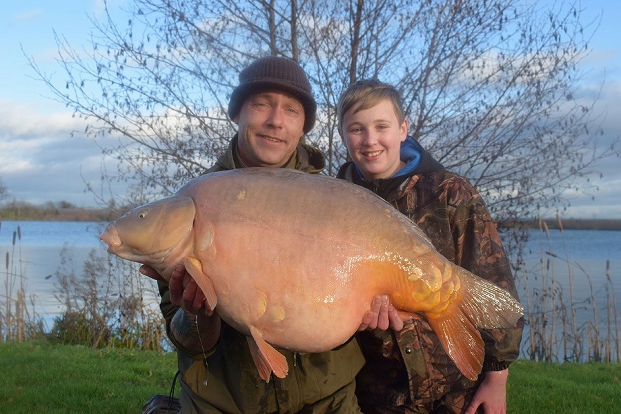 Dad Barry and son Oliver with the latter's 42lb mirror