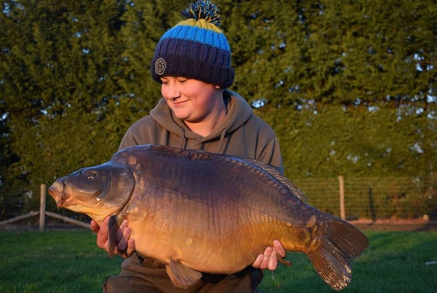 Jake White with Humpy at 34lb from M1