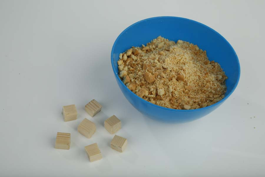 Crumble the biscuits and cut up the balsa wood into floater-size cubes