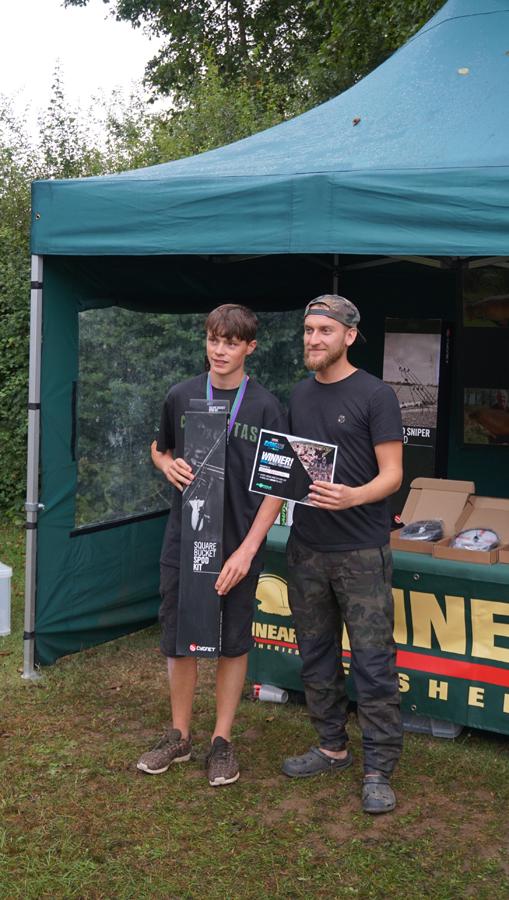 Tom Dove giving Adam Biddulph his biggest-fish prize