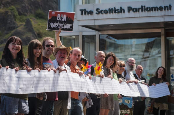 Campaigners with the list of petition signatories.
