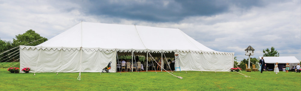 Main tent - £2500 - 33 x 64 ft Traditional Marquee with up-lighters, central lights and coconut matt flooring