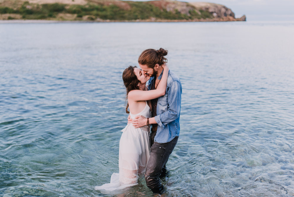 couple kissing during the engagement photoshoot at the irish coast.jpg