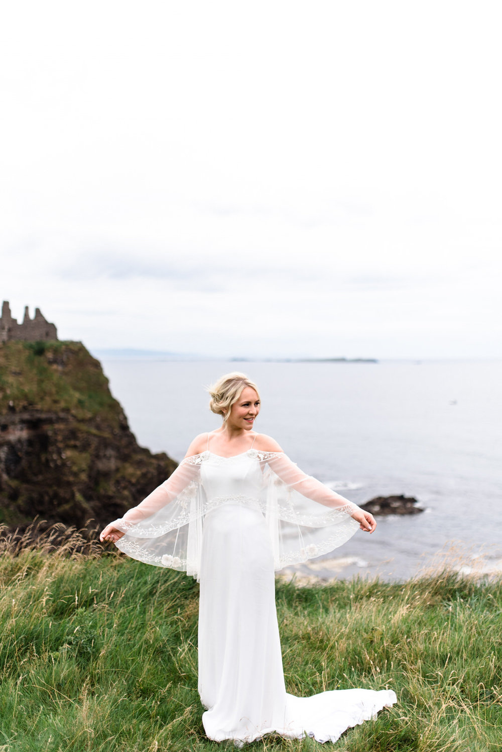 fine art dunluce castle elopement in ireland in sage and white, cliffs of northern ireland, bo and luca wedding dress-1.jpg