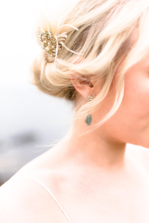 fine art dunluce castle elopement in ireland, green earrings, sage wedding details-1.jpg