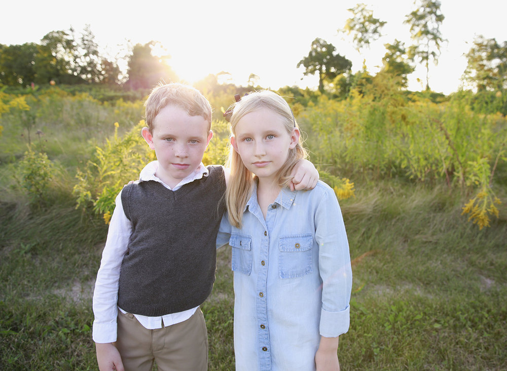 brother and sister portrait session at anthony road winery on seneca lake