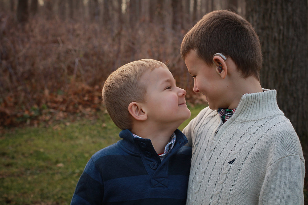 brothers looking at each other during family photo session