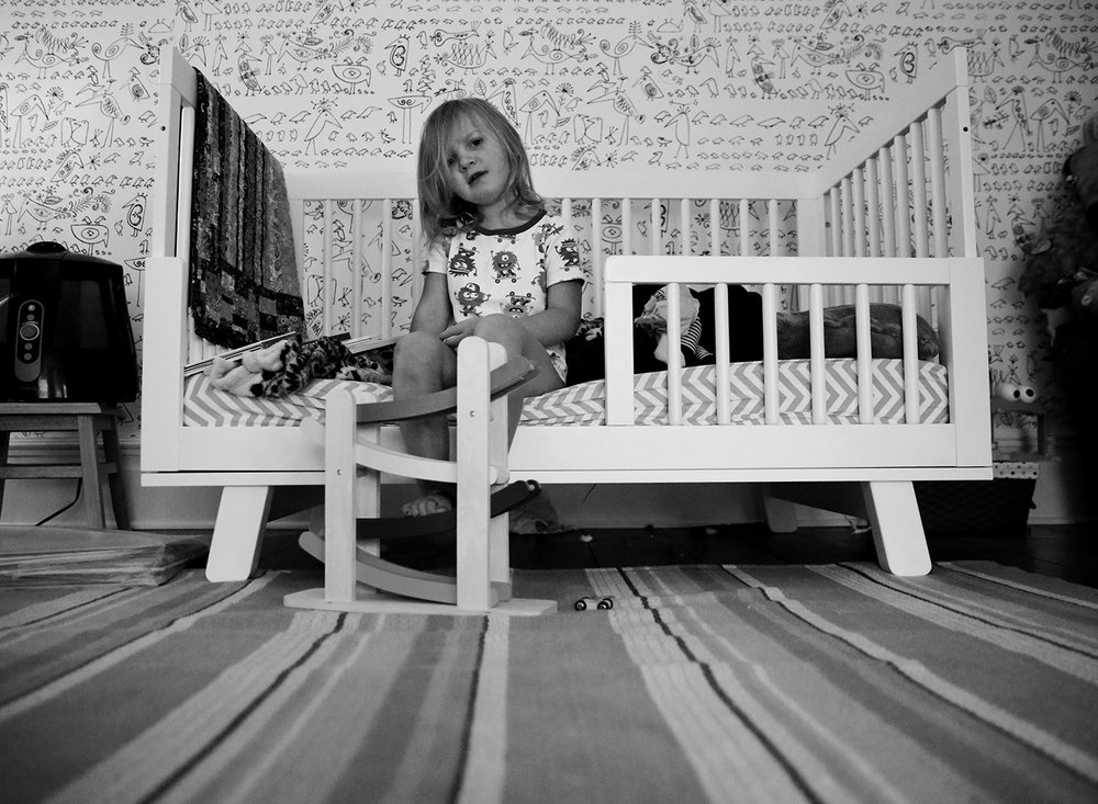 child in bedroom during lifestyle photo session penn yan new york
