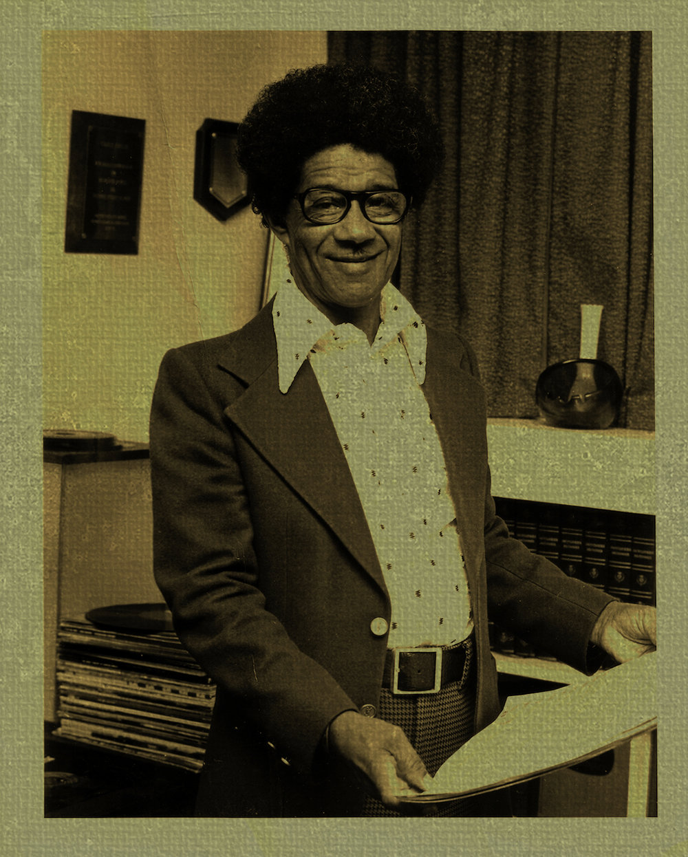 Conrad O. Johnson Sr. holding a Kashmere Stage Band record.jpg