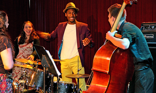 Jon Batiste, musician and bandleader for The Late Show with Stephen Colbert leads a musical master class in 2017 at The Knick with students of the RI Philharmonic Music School.