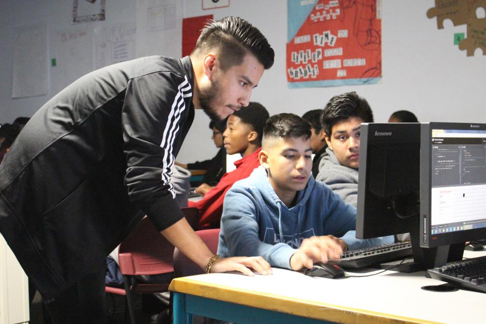 Luis Rocha at an Hour of Code event,where he taught freshman at a local high school the basics of code and the tech industry.