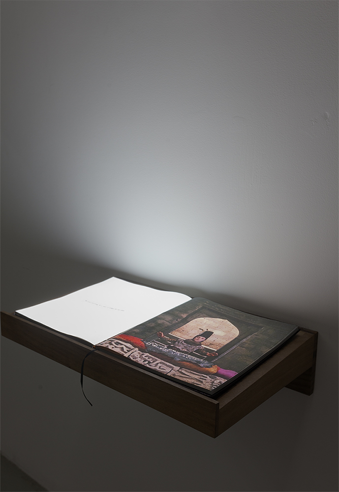 A book for a film (Sayat),  2017  Full HD Video projection on open book  Book; 30.5 x 34 x 2.7 cm, Lectern; 65 x 39.5 x 15 cm
