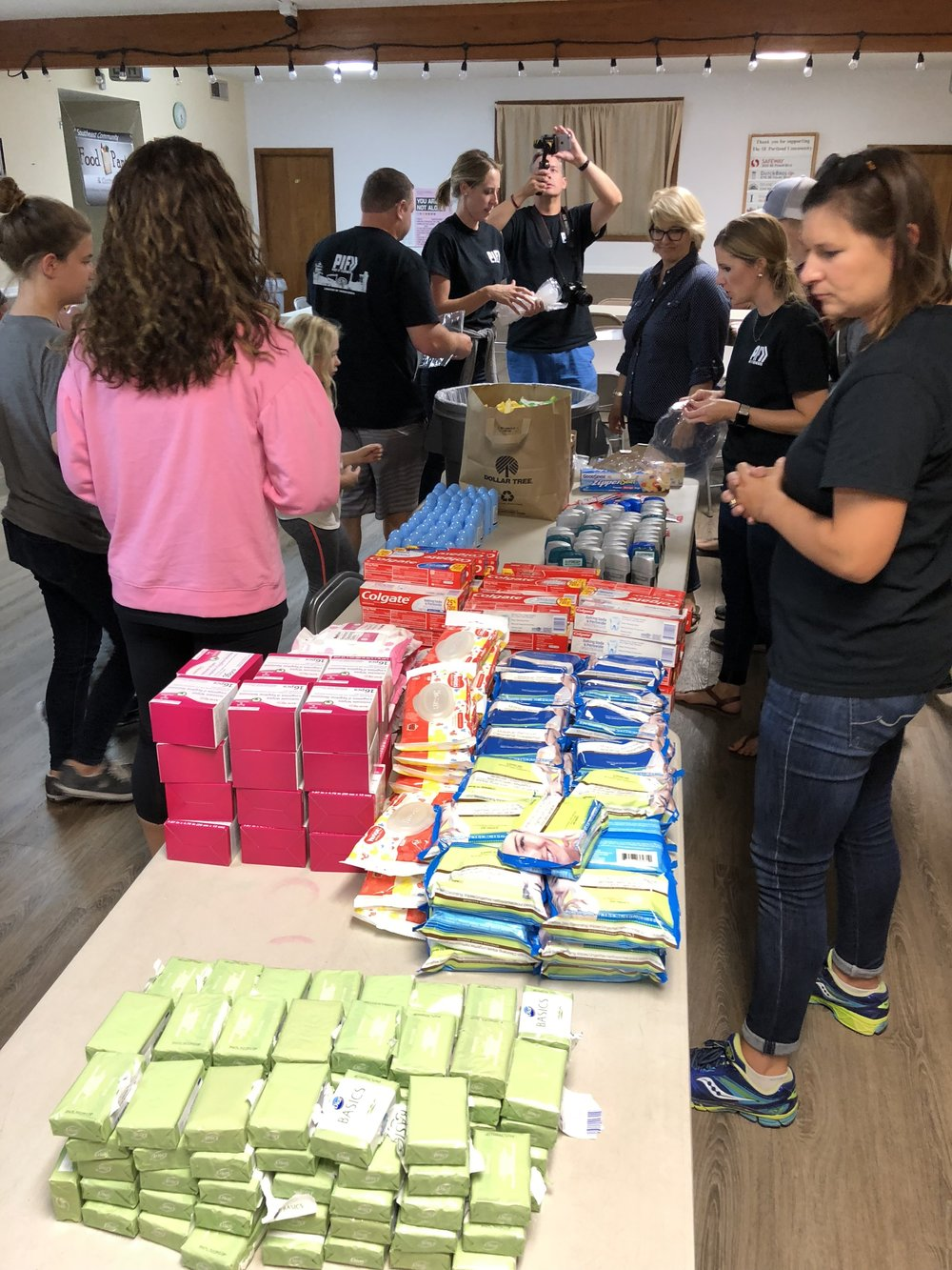 Putting together hygiene kits for our homeless neighbors.