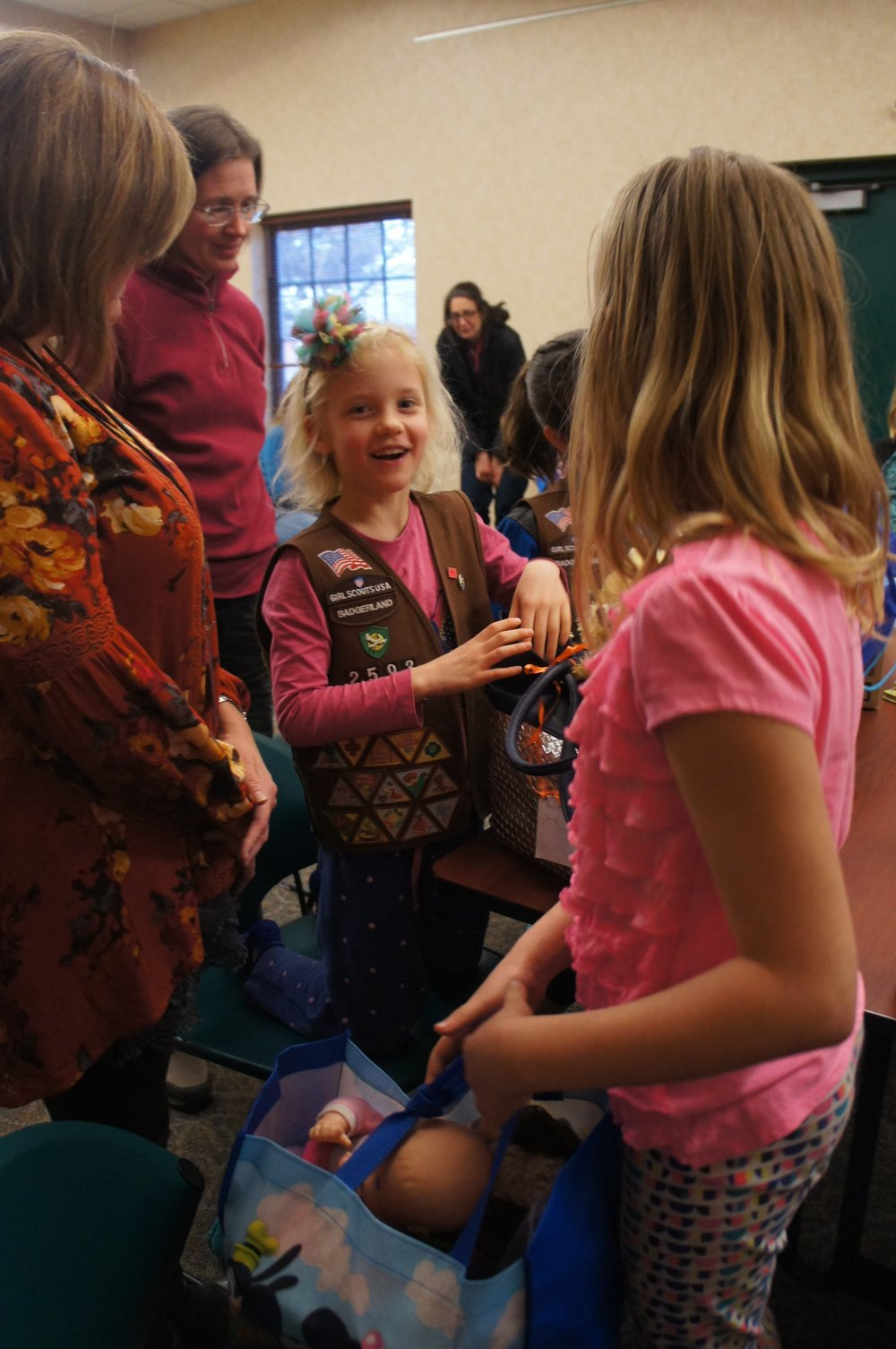 Girl Scout Troop #2593 gives children's care packages to refugees.
