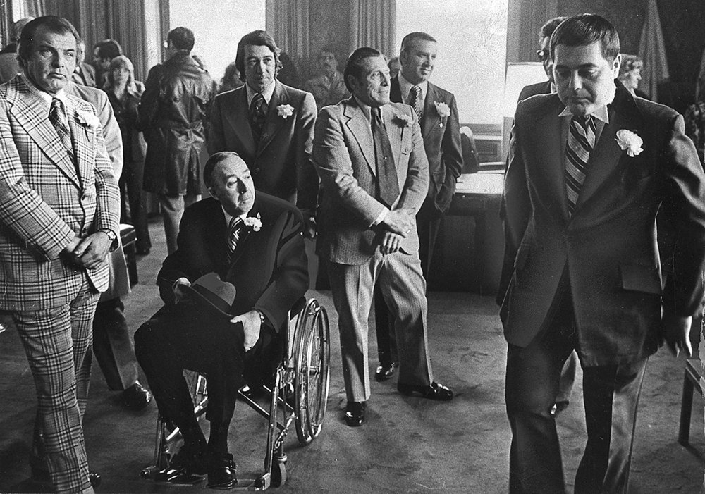 Buddy, right, hurries around his office as he prepares for his inauguration ceremony on January 7, 1975. Among the guests is Larry McGarry, the chairman of the local Democratic Party, in a wheelchair. McGarry was one of the major power players who helped win Democratic support for Buddy. He even allegedly called upon mob enforcer Jerry Tillinghast to help round up votes.  Providence Journal file photo/Thomas D. Stevens