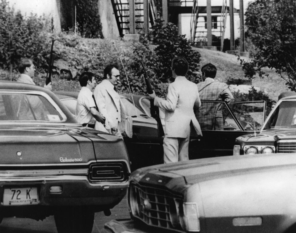 In July 1976, just a few months into the trial, armed guards accompany Robert Dussault into the Franklin County Courthouse in Greenfield, Massachusetts. Courtesy of the Providence Journal.