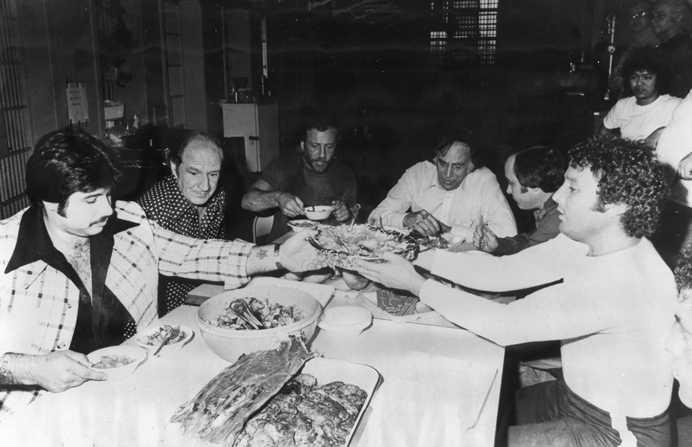 George Basmajian, far left, enjoys a lavish meal at the Adult Correctional Institutions with other wiseguys in the early 1970s. Courtesy of the Providence Journal.