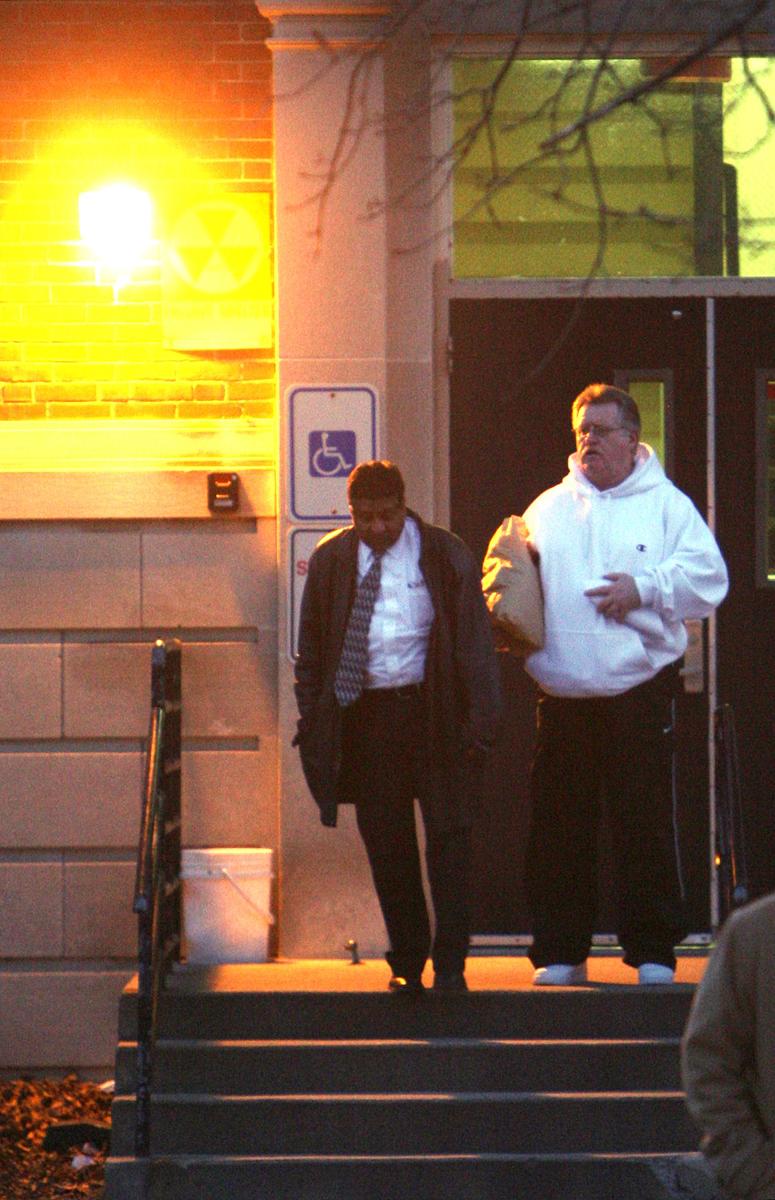 Jerry Tillinghast, right, as he is escorted from prison in 2007. Courtesy of the Providence Journal/Bob Breidenbach.