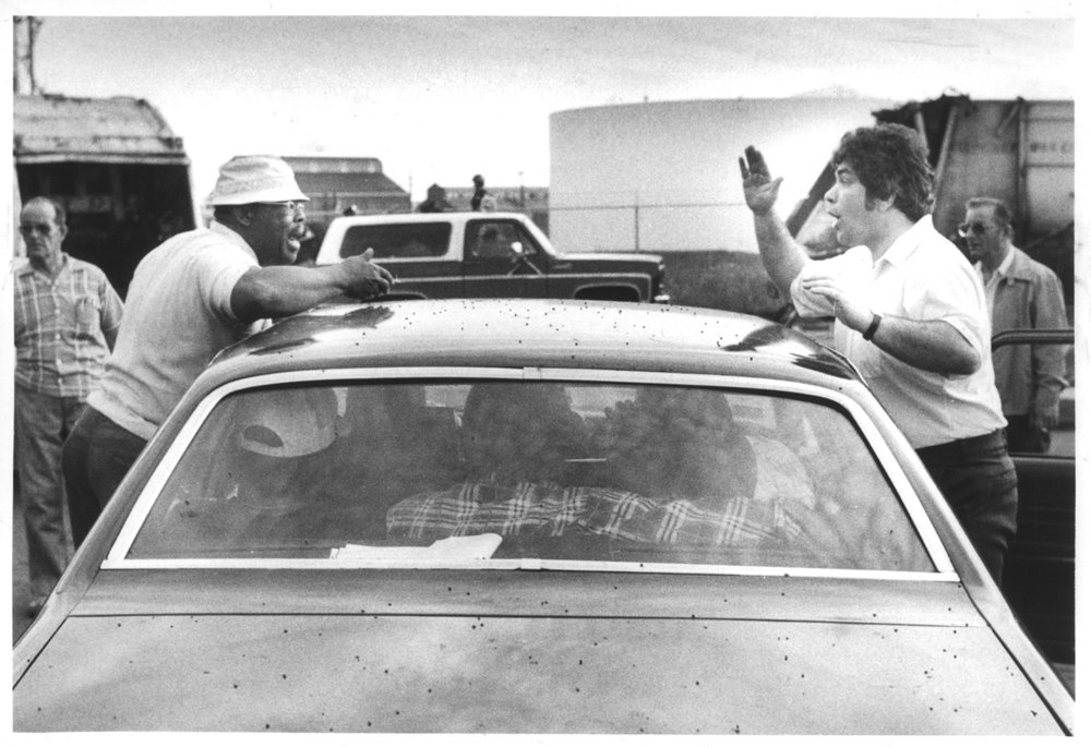 """In June 1981, Providence highway superintendent Edward """"Buckles"""" Melise, right, argues with a sanitation worker outside Providence's main garage. Courtesy of the Providence Journal/Peter Morgan."""