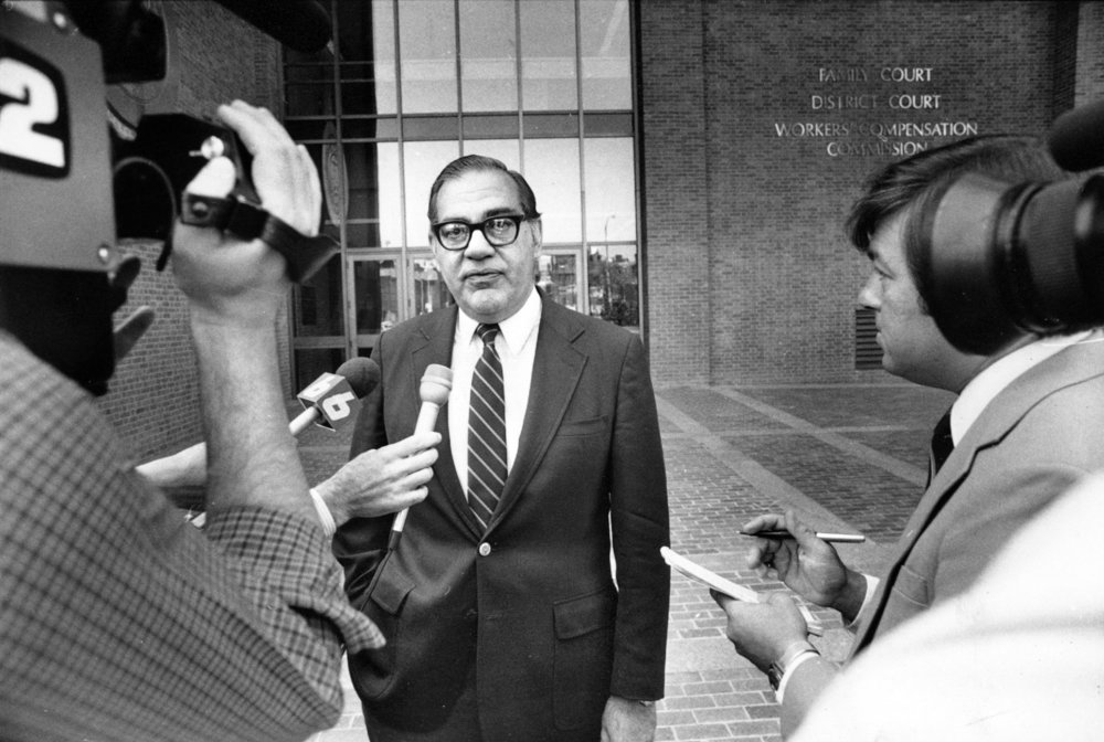 Herbert DeSimone was a friend of Buddy Cianci and Raymond DeLeo. DeSimone, pictured outside the courthouse a few months after the assault, was called on to end the dispute between Buddy and DeLeo. Courtesy of the Providence Journal/Andrew Dickerman.