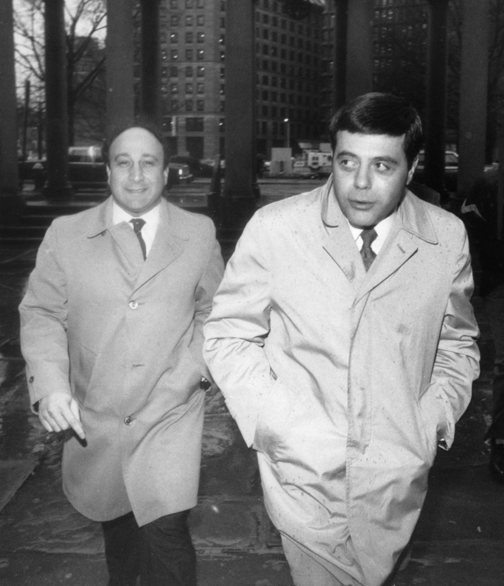 Buddy arrives at Superior Court in Providence in February of 1984. Charles Mansolillo, his chief aide, is pictured with him. Providence Journal file photo/Rachel Ritchie.