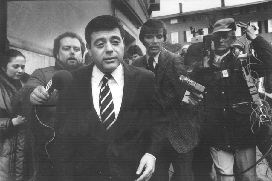 Buddy is pursued by reporters outside Superior Court in Providence. The assault on Raymond DeLeo became a national news story. Courtesy of the Providence Journal/Pamela Price.