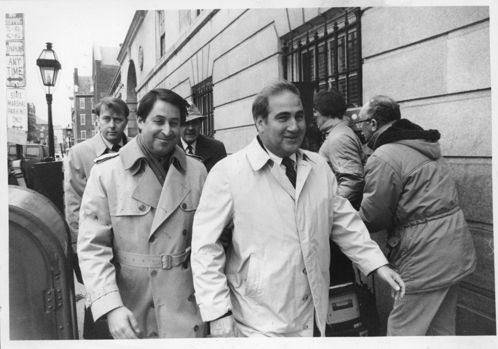 Raymond DeLeo, right, the man assaulted by Buddy, leaves Superior Court in Providence, accompanied by his attorney. On the night of March 20th, 1983, Buddy hit DeLeo, burned him with a cigarette and threatened him with a fireplace log. DeLeo always maintained that he and Sheila did not have an affair.  Courtesy of the Providence Journal/Thomas D. Stevens.