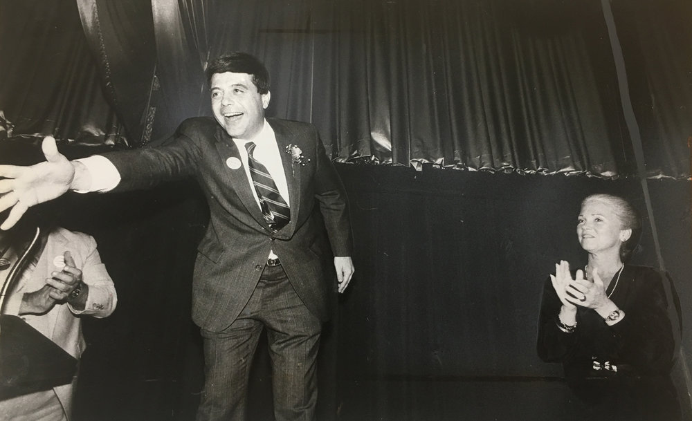 A jubilant Buddy greets supporters after winning another mayoral term in November of 1982. At right is his wife, Sheila. The two were in the process of separating at the time. Courtesy of the Providence Journal.