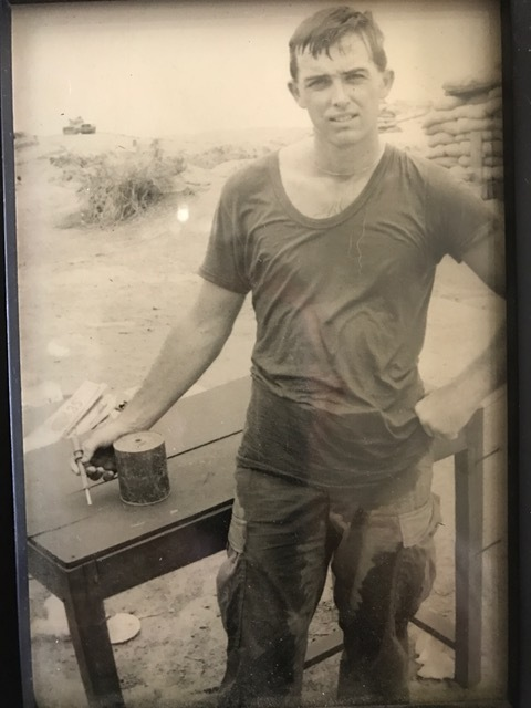 Brian Andrews fought for the Marine Corps in Vietnam. Pictured here in 1967, he poses with a defused booby trap at the U.S. military base of Chu Lai. Courtesy of Brian Andrews.