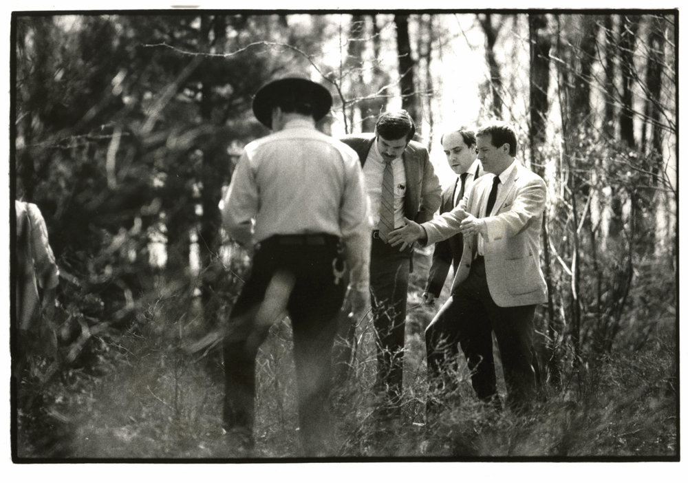 Rhode Island Assistant Attorney General Michael Burns, right, gestures over a hole in Rehoboth, Massachusetts, in 1986, where Dickie Callei was allegedly buried by Bobo Marrapese. Bobo was found guilty of that murder and sentenced to life in prison. At 74, Bobo is still serving time today. Courtesy of the Providence Journal/Mary Murphy.