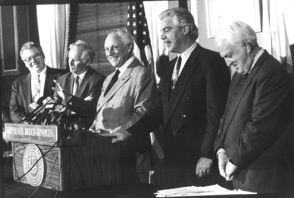 Governor Bruce Sundlun, center, created the Rhode Island Depositors Economic Protection Corporation, or DEPCO, to raise money for depositors by selling bonds.  Courtesy of The Providence Journal/Mary Murphy.